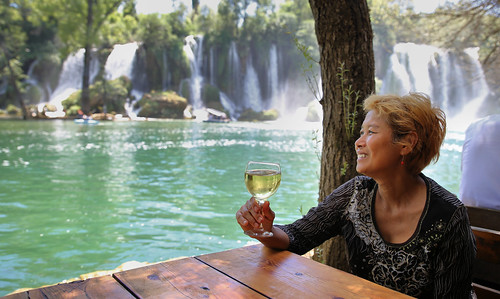 Kanitha enjoying Kravice and a local glass wine