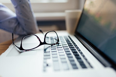Glasses on Macbook closeup.