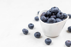 Fresh Blueberries above white background with copy space