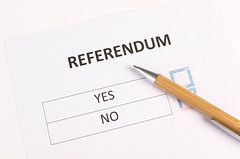 Referendum form with wooden pencil on white table