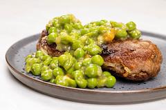 Served Meatballs with cooked Green Peas