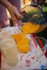 Woman pouring orange juice into glass