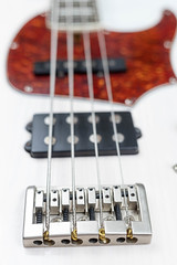 Bass Guitar Bridge with blurred body in the background