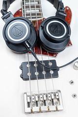 Bass Guitar Bridge with Studio Headphones on the guitar
