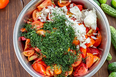 Chopped fresh vegetables and herbs for making summer vegetarian salad