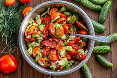 Salad with cucumbers, tomatoes, onions, dill with soy sauce and sunflower oil