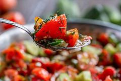 Vegetable salad in a spoon, close-up