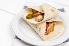 Tortillas with fried Chicken Meat and Vegetables served on the plate