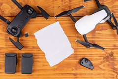 Top view of DJI Mavic Air drone with copy space on the blank white paper