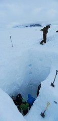 Student researchers dig snow pits