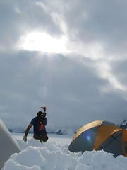 Tending to snow walls in a field camp on the Taku Glacier