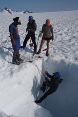 Sampling a snowpit on a glacier in Alaska