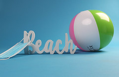 Beach ball with medical face mask and beach text on blue background