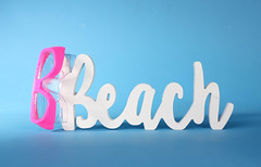 Beach text with diving mask on blue background
