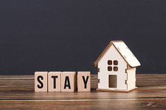 Stay home concept with wooden blocks