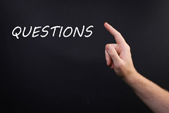Human hand point with finger and Questions text