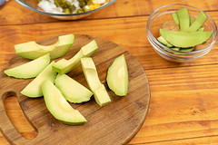 Sliced Avocado on the round wooden board