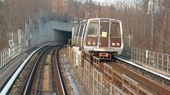Green Line train entering tunnel portal