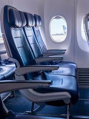 Empty row of airplane seats