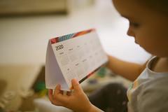 Young girl holding calendar