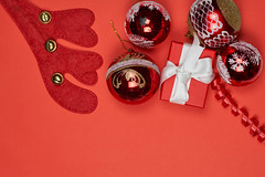 Xmas decorative background on red. Overhead view