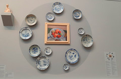 Adelaide. Art Gallery of South Australia. Collage of fruit bowls in blue and white pottery with still life fruit painting.
