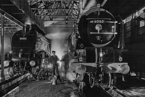 """Railway workers stopf for a chat whilst attending to majestic steam locomotives """"Sir Nigel Gresley"""" and """"Tornado"""" in an engine shed at night. (EXPLORED)"""