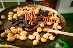 Open Kitchen With Grilled Potatoes, Meat And Saussages