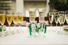 Two Champagne Glasses With Green Decor