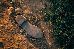 Shoe sole left in the dirt