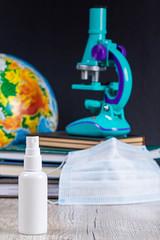 Close-up, bottle of antiseptic on school background