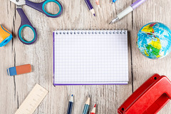 School supplies on a wooden background, top view