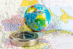 Compass and globe on the map background