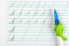 Notebook for teaching children to write letters and pen