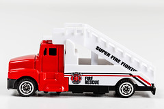 Toy plastic fire truck on white background