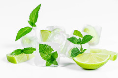 Lime and mint with ice cubes on a white background