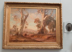 Adelaide. Art Gallery of South Australia. One of Sir Hans Heysen's famous morning light paintings of the Adelaide Hills near Hahndorf with one of his old hats beside it.