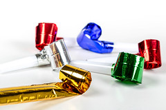 Multicolored air whistles on a white background