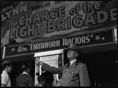 Spruiker, outside film theatre showing Charge of the Light Brigade, ca. 1936