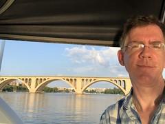 Paul in James's boat, Potomac River and view of Key Bridge, Washington, D.C.