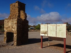 Historic Blinman old copper mining town of the Flinders Ranges. Chimney ruin and information boards on the town.