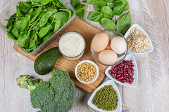 Milk, eggs, vegetables, oatmeal, beans and nuts - the concept of a varied healthy diet