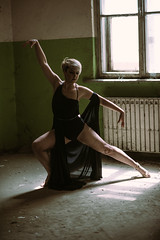 Model dancing in an old building.