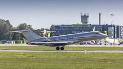 VistaJet Bombardier Global 6000 Leaving Riga on a hot summer day