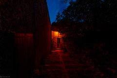Small dimly lit streets leading away from The Notre-Dame du Roc Castel chapel des Le Caylar France