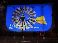 Karoonda in the Murray Mallee. Night illumination on the Karoonda wheat silos. Art work  from the SA Living Artists exhibition of August 2020. Illuminations nightly to 9 pm. Changed monthly. A windmill...