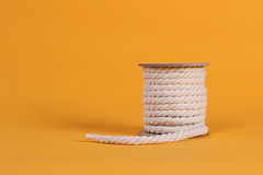 Rope roll on orange background with copy space