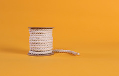 Rope roll on orange background