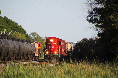 G64 returns from a run to Madison as 586 crawls along the siding