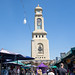 Bangkok, Thailand - November 30, 2019: Famous clock tower at Chatuchak Weekend Market, is a notable meeting place for shoppers (English translation - Clock Tower)
